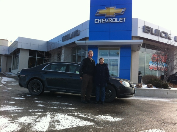 Sales and Leasing Representative Gary Allen with valued customer in front of Highland Chevrolet Buick GMC Cadillac